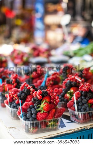 assorted fruit in containers - stock photo