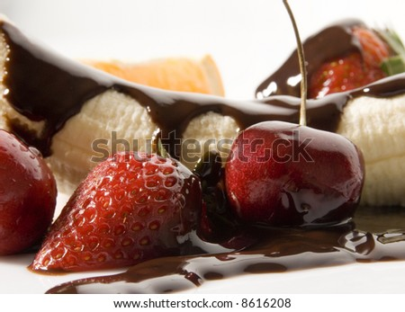 assorted fruits and chocolate sauce still life isolated over white background - stock photo