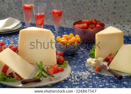 Assorted hard cheeses on christmas decorated table. - stock photo