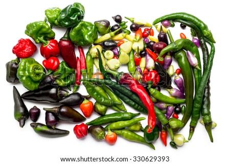 Assorted hot peppers, red hot red, green, habanero, jalapeno, chilli - stock photo