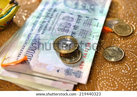 Assorted indian currency and coins. It is considered as a Goddess Laxmi in india.  - stock photo