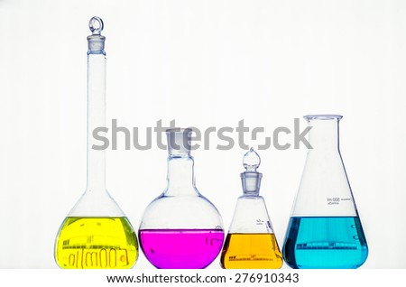 Assorted laboratory glassware equipment ready for an experiment in a science research lab - stock photo