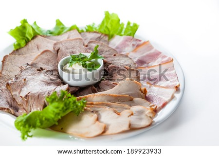 Assorted meat with bacon, ham and lettuce - stock photo