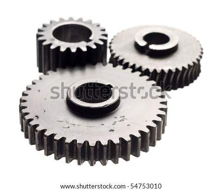 Assorted metal gears on white - stock photo