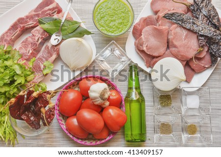 Assorted mexican food ingredients to make stew - stock photo