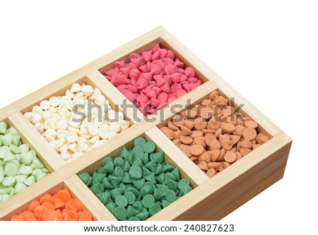 Assorted mix flavored nipple chips in box on white  - stock photo