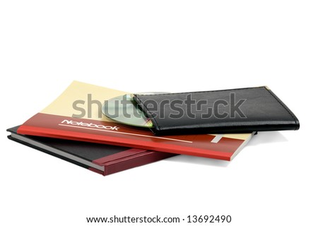 assorted notebooks with a cd flat piled on white background - stock photo