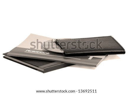 assorted notebooks with a cd flat piled on white background,sepia filter - stock photo