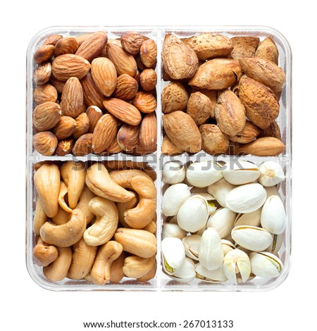 Assorted nuts in a box; Pistachio nuts,Cashew nuts,Inshell almonds - stock photo