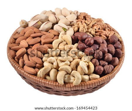Assorted nuts in a wicker bowl isolated on a white background - stock photo