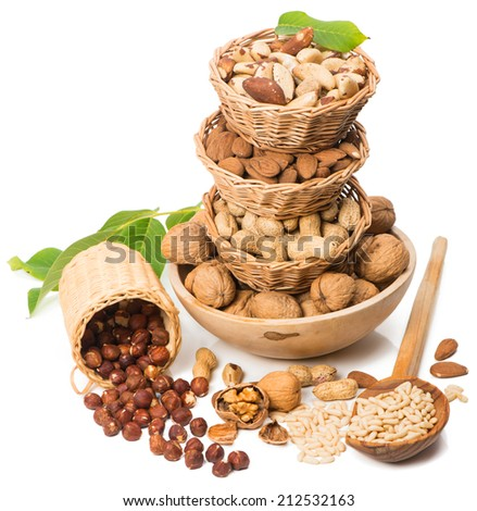Assorted nuts in baskets  isolated over white - stock photo