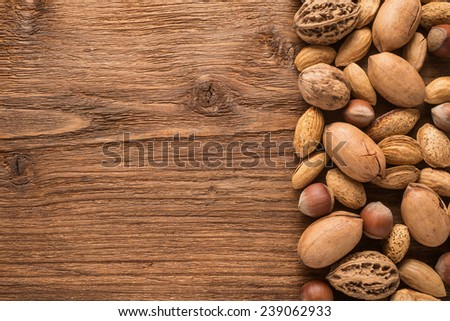 Assorted nuts on a wooden background  - stock photo