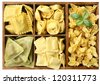 assorted pasta with fillings in a wooden box (manual focus) - stock photo