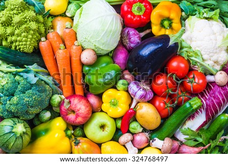 Assorted raw vegetables and fruits. - stock photo
