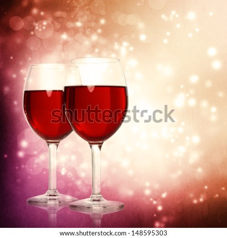 Assorted Red Wine Glasses on a Sparkling Backdrop - stock photo