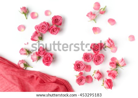 Assorted roses heads. Various soft roses and leaves scattered on a white background, overhead view. Flat lay - stock photo