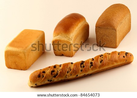 Assorted sandwich bread loaves and a chocolate chip milk bread - stock photo