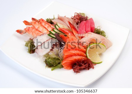 Assorted Sashimi great. Salmon, octopus, shrimp, yellowtail, clam, tuna, perch - stock photo