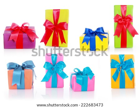 Assorted Sizes and Colors Gift Boxes with Big Ribbons Isolated on White Background. - stock photo