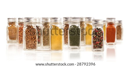 Assorted spice bottles isolated on white - stock photo