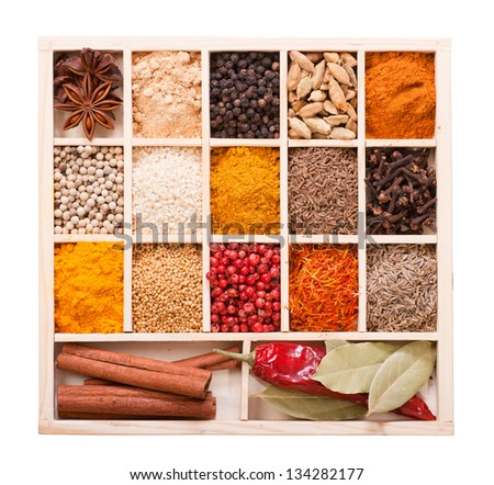 Assorted spices in the wooden box isolated on white background - stock photo