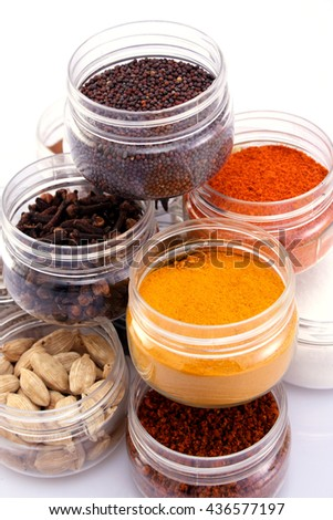 Assorted spices on plastic containers - stock photo