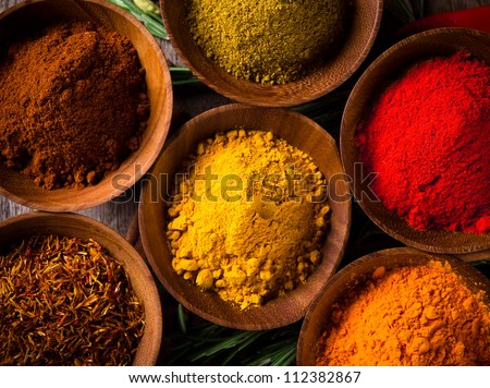 Assorted spices with fresh herbs - stock photo