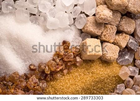 Assorted sugar background closeup shot - stock photo