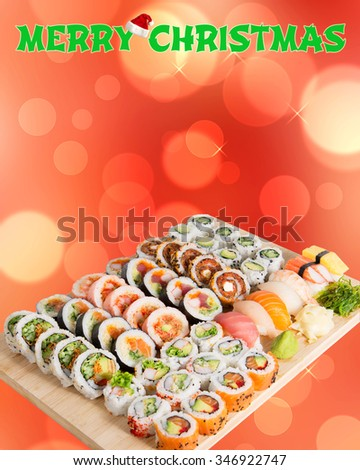 Assorted Sushi rolls on a Christmas background - stock photo