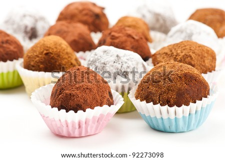 Assorted truffles on white background - stock photo