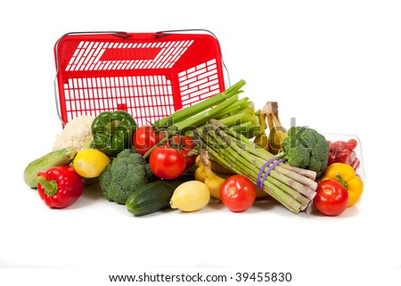 Assorted vegetables and fruits including asparagus, celery, tomatoes, peppers, bananas, lemons, cauliflower, cherry tomatoes, broccoli, cucmber and squash with a grocery sack on a white background - stock photo