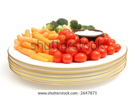assorted vegetables on plate w/dip center - stock photo