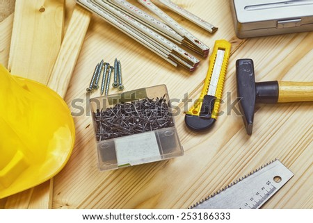 Assorted Woodwork and Carpentry or Construction Tools on Pine Wood Texture Background, top view - stock photo