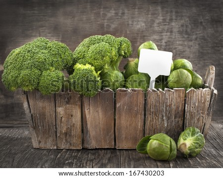 Assortment cabbages on wooden background - stock photo