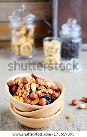 assortment nuts in ceramic bowl, food closeup - stock photo