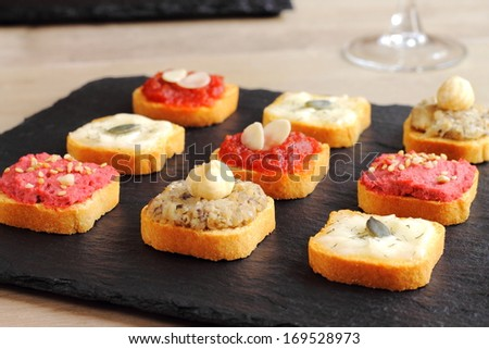 Assortment of canapes - stock photo