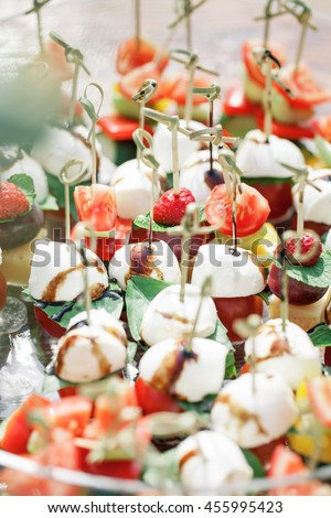 Assortment of canapes. Banquet service. - stock photo