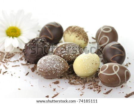 assortment of chocolate eggs on white background - stock photo
