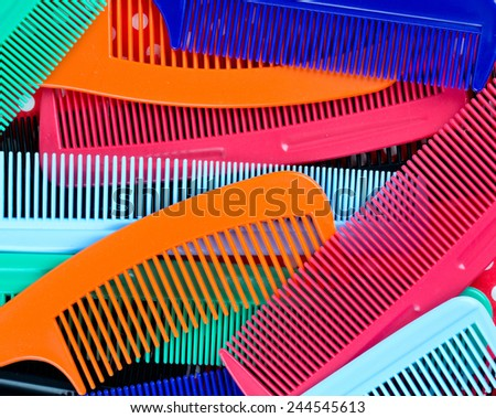 assortment of colorful hair combs  - stock photo