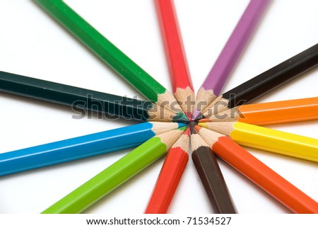Assortment of Coloured Pencil Crayons on a White Background - stock photo
