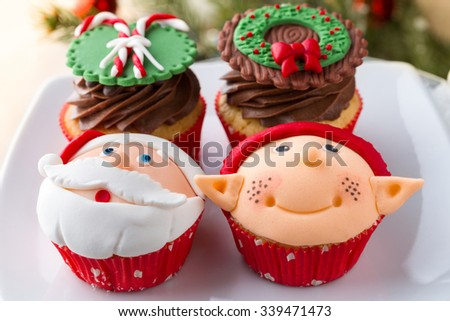 Assortment of decorated cupcake for Christmas - stock photo