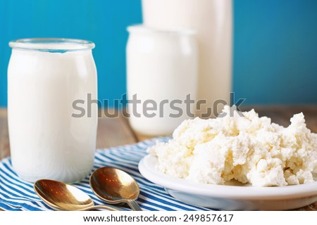 Assortment of diary products for breakfast homemade cottage cheese, yogurt and milk). Selective focus - stock photo