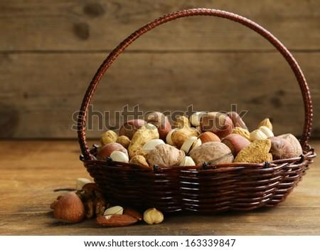 Assortment of different nuts (peanuts, hazelnuts, pistachios, walnuts) - stock photo