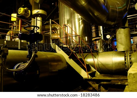 assortment of different size and shaped pipes at a power plant - stock photo