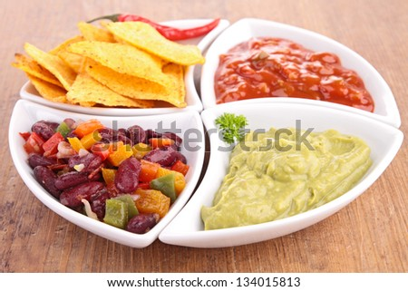 assortment of dips and tortillas chips - stock photo