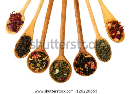 assortment of dry tea in spoons, isolated on white - stock photo
