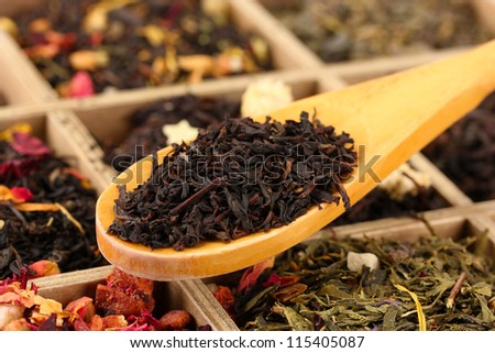 assortment of dry tea in wooden box, close up - stock photo