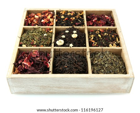 assortment of dry tea in wooden box, isolated on white - stock photo