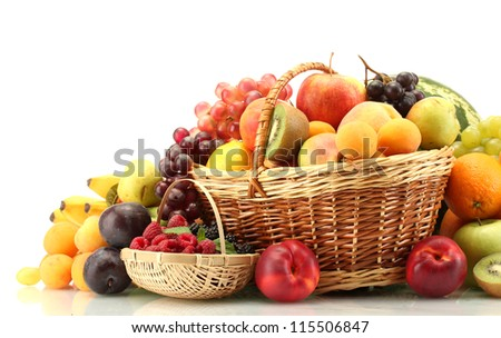 Assortment of exotic fruits and berries in baskets isolated on white - stock photo