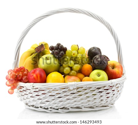 Assortment of exotic fruits in basket isolated on white - stock photo